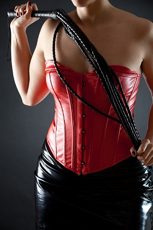 woman in red leather corset with black whip dating cuck hubby